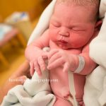 newborn baby with umbillical cord still attached