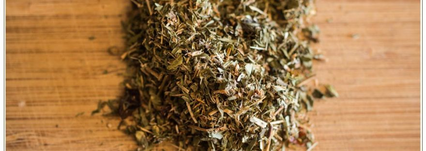 dried-herbs-on-wooden-cutting-board